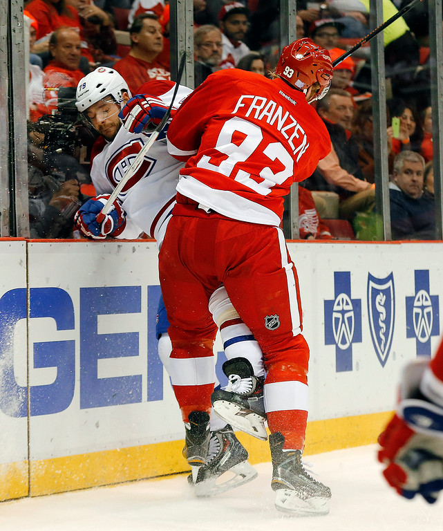 . Detroit Red Wings left wing Johan Franzen (93) checks Montreal Canadiens defenseman Andrei Markov (79) in the first period of an NHL hockey game in Detroit, Sunday, Nov. 16, 2014. (AP Photo/Paul Sancya)