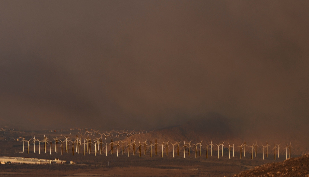 . Thick black smoke blows over wind farm from the Silver Fire near Banning, California August 7, 2013.  Hundreds of residents of three small communities in the high desert east of Los Angeles were evacuated on Wednesday as an out-of-control wildfire headed toward them.   Photo by Gene Blevins/LA Daily News