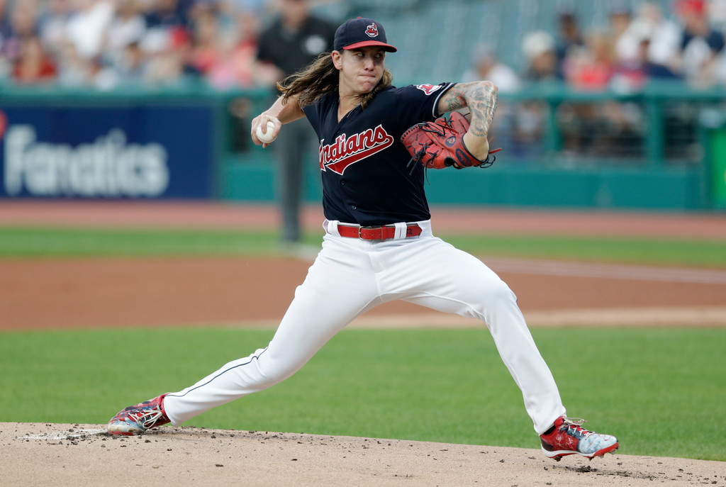 . Cleveland Indians starting pitcher Mike Clevinger delivers in the first inning of a baseball game against the Kansas City Royals, Tuesday, Sept. 4, 2018, in Cleveland. (AP Photo/Tony Dejak)