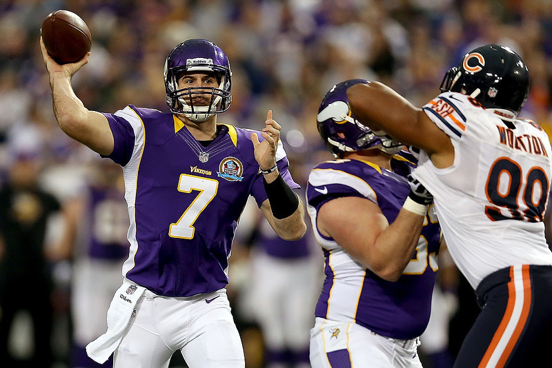 . Quarterback Christian Ponder #7 of the Minnesota Vikings throws against the Chicago Bears at Mall of America Field on December 9, 2012 in Minneapolis, Minnesota.  (Photo by Matthew Stockman/Getty Images)