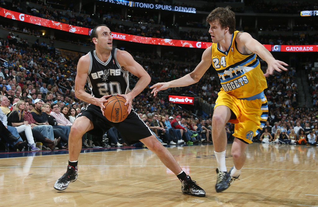 . San Antonio Spurs guard Manu Ginobili, left, of Argentina, looks to shoot ball as Denver Nuggets forward Jan Vesely, of the Czech Republic, covers in the fourth quarter of the Spurs\' 133-102 victory in an NBA basketball game in Denver, Friday, March 28, 2014. (AP Photo/David Zalubowski)