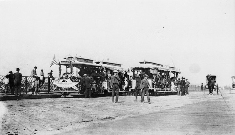 Streetcars and spectators on the First Street Bridge during the opening of the cable railway to Boyle Heights, Los Angeles, August 1, 1889