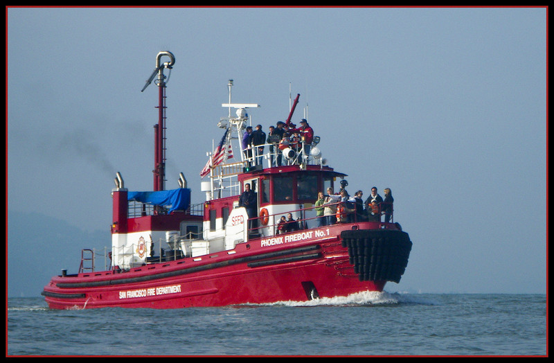 A fire boat returning to Pier 1 - looks like family day on the boat.