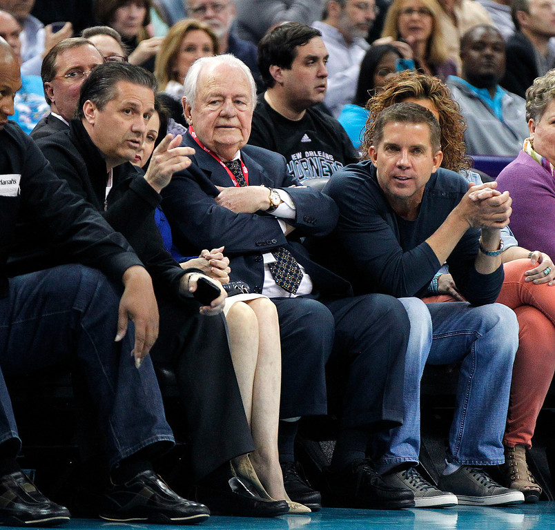 . John Calipari, head NCAA college basketball coach for Kentucky, left, talks with New Orleans Hornets and NFL football New Orleans Saints owner Tom Benson, center, and Saints head coach Sean Payton in the first half of an NBA basketball game against the Los Angeles Clippers in New Orleans, Wednesday, March 27, 2013. (AP Photo/Gerald Herbert)