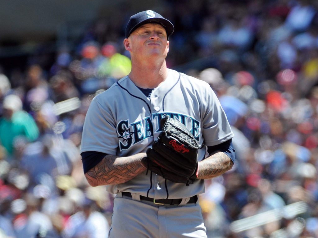 . Mariners starter Jeremy Bonderman winces after giving up a home run to Minnesota\'s Chris Herrmann during the fourth inning. (AP Photo/Craig Lassig)