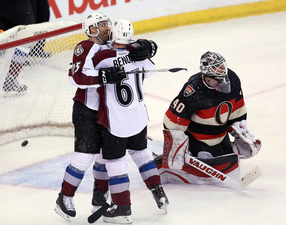 . Ottawa Senator goaltender Robin Lehner(40) looks on as Colorado Avalanche\'s Andre Benoit (61) celebrates his goal with teammate Maxime Talbot (25) during second-period NHL hockey game action in Ottawa, Ontario, Sunday, March 16, 2014. (AP Photo/The Canadian Press, Fred Chartrand)