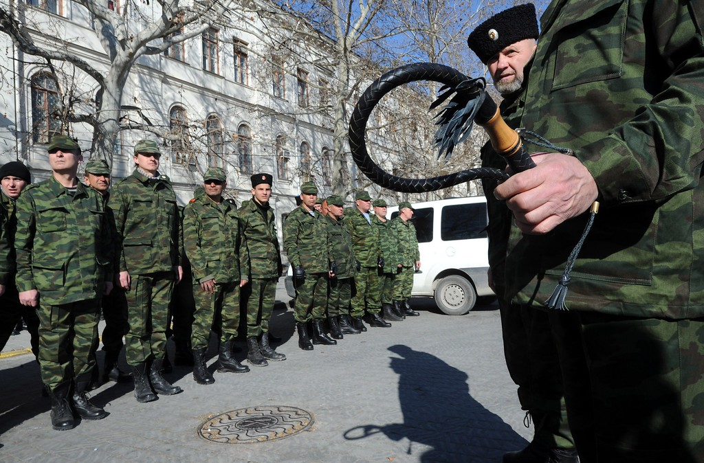 . A pro-Russian cossacks volunteer holds a whip during an oath-taking ceremony in Sevastopol, on March 15, 2014, the day before the referendum in Crimea. Ukraine braced for a breakaway vote in Crimea as deadly violence flared again in the ex-Soviet country\'s tinderbox east amid the biggest East-West showdown since the Cold War.  AFP PHOTO / VIKTOR DRACHEV/AFP/Getty Images