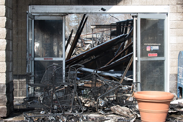 03/04/19 Wesley Bunnell | Staff Fire destroyed Tops Marketplace located at 887 Meriden-Waterbury Tpke in Southington on Monday night. The front entrance to the store.