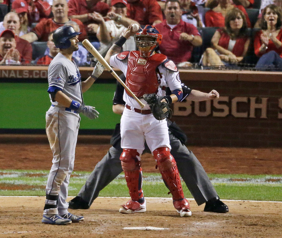 . Los Angeles Dodgers\' Andre Ethier reacts in front of St. Louis Cardinals\' Yadier Molina after striking out during the sixth inning of Game 1 of the National League baseball championship series Friday, Oct. 11, 2013, in St. Louis. (AP Photo/Chris Carlson)
