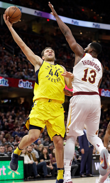 . Indiana Pacers\' Bojan Bogdanovic shoots over Cleveland Cavaliers\' Tristan Thompson during the second half of an NBA basketball game Friday, Jan. 26, 2018, in Cleveland. The Cavaliers won 115-108. (AP Photo/Tony Dejak)