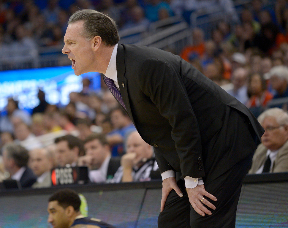 . Pittsburgh coach Jamie Dixon yells at his team during the first half in a third-round game in the NCAA college basketball tournament against Florida, Saturday, March 22, 2014, in Orlando, Fla. (AP Photo/Phelan M. Ebenhack)