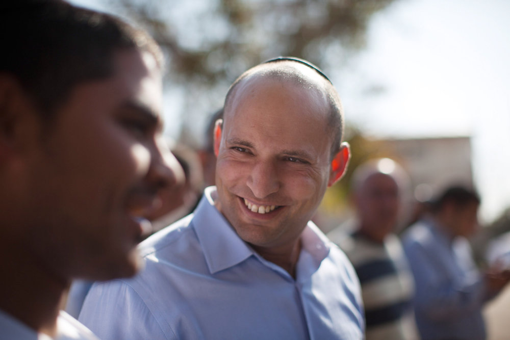 . Naftali Bennett, head of HaBayit HaYehudi Party, the Jewish Home party, talks to students at a pre-army training school as he campaigns at the Shapira Center on January 20, 2013 near Ashkelon, Israel. The religious Jewish Home party is challenging Benjamin Netanyahu\'s Likud party as Israel heads for a general election on January 22.  (Photo by Uriel Sinai/Getty Images)
