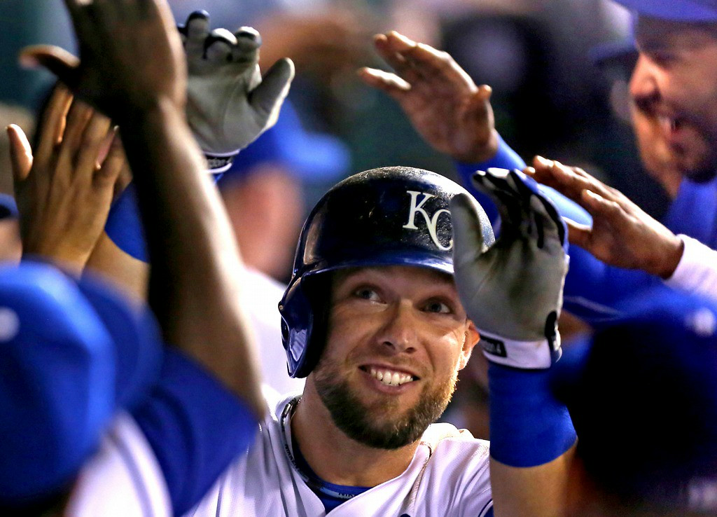 . Kansas City\'s Alex Gordon celebrates his game-tying home run with teammates in the seventh inning against the Twins. (Photo by Ed Zurga/Getty Images)