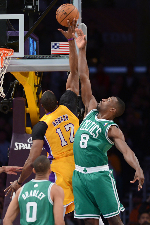 . Lakers Dwight Howard drops in two as Celtics\' Jeff Green defends during first half action at Staples Wednesday.  Photo by David Crane/Staff Photographer