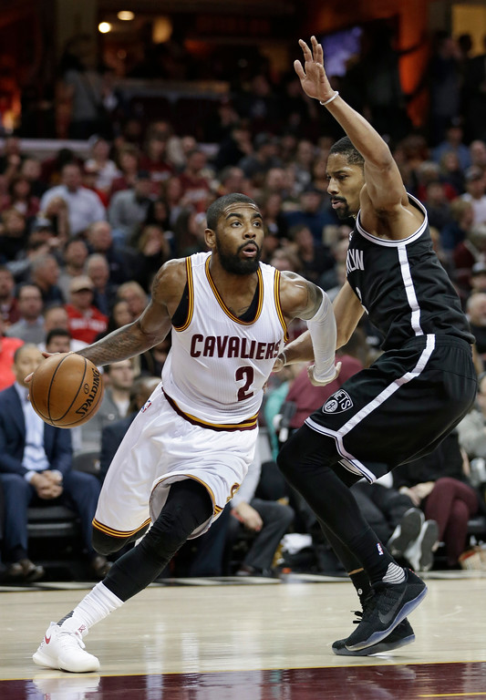 . Cleveland Cavaliers\' Kyrie Irving (2) drives against Brooklyn Nets\' Spencer Dinwiddie (8) in the second half of an NBA basketball game, Friday, Jan. 27, 2017, in Cleveland. (AP Photo/Tony Dejak)