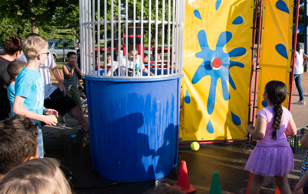 06/08/18 Wesley Bunnell | Staff Vance Elementary School held an end of the year celebration on Friday night for students and parents. Vance Second grader Yanziel J. Rodriguez is dunked by a classmate.