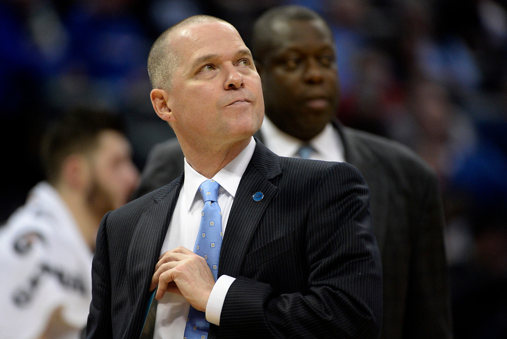 . Michael Malone of the Denver Nuggets watches the action against the Charlotte Hornets during the second quarter. The Denver Nuggets hosted the Charlotte Hornets at the Pepsi Center on Sunday, January 10, 2016. (Photo by AAron Ontiveroz/The Denver Post)