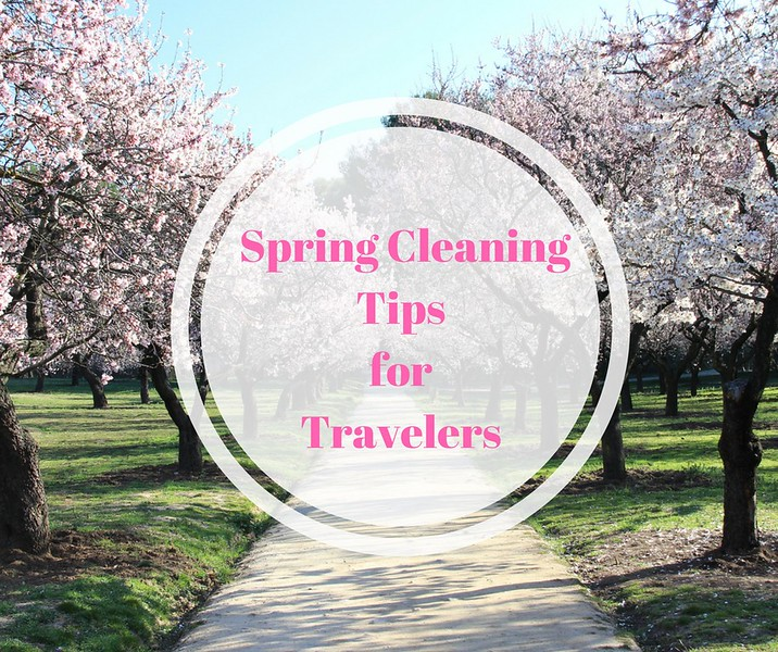 Blooming trees in a park remind us that it's time to use our spring cleaning tips for travelers.