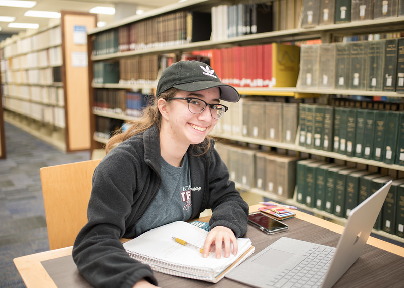 Clarissa Trainer works on her chemistry homework in the Mary and Jeff Library.