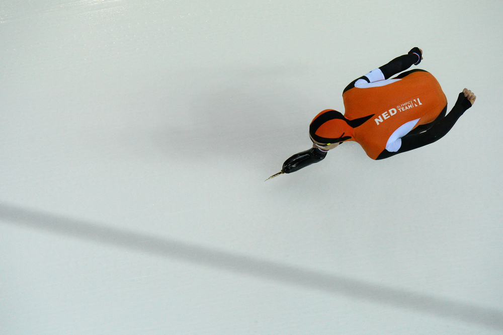 . A picture taken with a robotic camera shows Netherlands\' Jorrit Bergsma competing in the Men\'s Speed Skating 5000m at the Adler Arena during the 2014 Sochi Winter Olympics on February 8, 2014.  (ANTONIN THUILLIER/AFP/Getty Images)