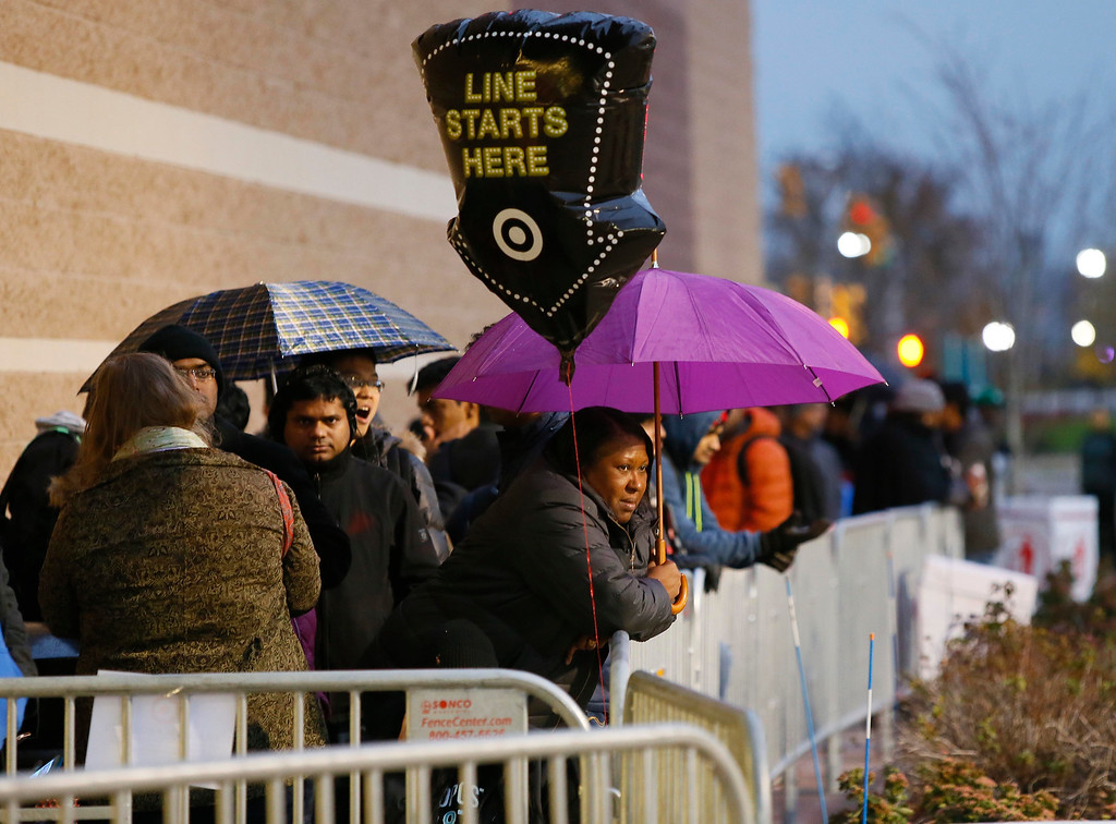 . Guests wait for Black Friday sales before Target doors open at 6 p.m., Thursday, Nov. 24, 2016, in Jersey City, N.J. (Photo by Noah K. Murray/Invision for Target/AP Images)