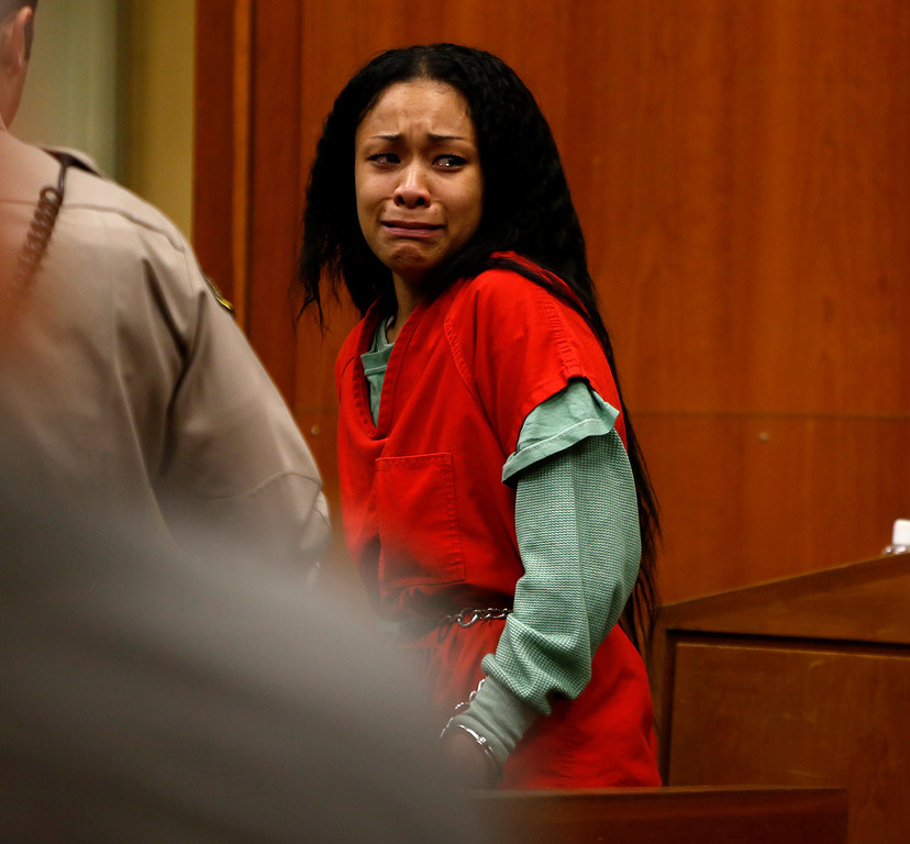 ". Raven Dixon reacts as she enters the courtroom and looks and family and friends at the Santa Clara County Hall of Justice in San Jose, Calif., on Tuesday, Jan. 15, 2013.  Dixon is one of four co-defendants facing murder charges in the home invasion that resulted in the death of Monte Sereno businessman Raveesh ""Ravi\"" Kumra.  (Nhat V. Meyer/Staff)"