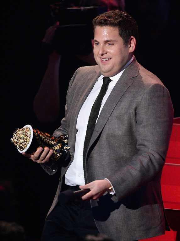 . Actor Jonah Hill accepts the Best Comedic Performance award for \'The Wolf of Wall Street\' onstage at the 2014 MTV Movie Awards at Nokia Theatre L.A. Live on April 13, 2014 in Los Angeles, California.  (Photo by Kevork Djansezian/Getty Images for MTV)
