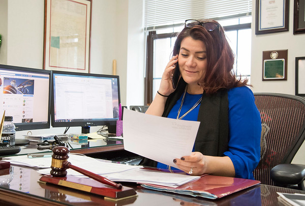 03/19/20 Wesley Bunnell | StaffrrMayor Erin Stewart working in her office on Thursday afternoon March 19, 2020 as she looks over official paperwork requiring her attention. City Hall has restricted access for visitors asking they all visit Room 108 upon entrance.