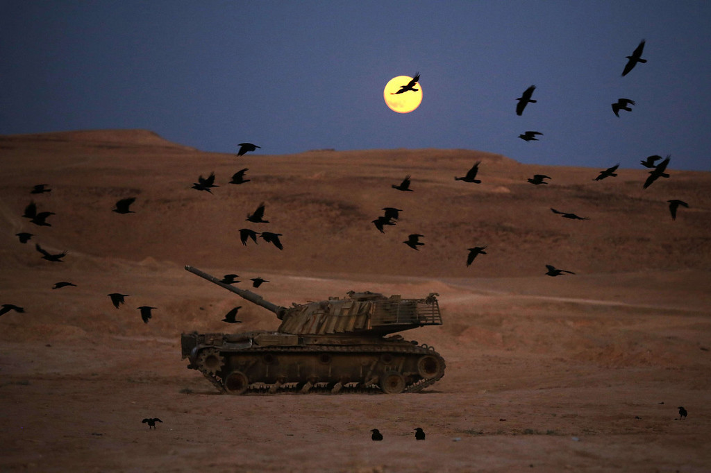 ". A full moon rises in the Israeli occupied Palestinian West Bank on June 23, 2013. This ""super moon\"" also known as a \""perigee\"" full moon appears about 14 percent larger and 30 percent brighter than a regular full moon, according to NASA scientists.  MENAHEM KAHANA/AFP/Getty Images"
