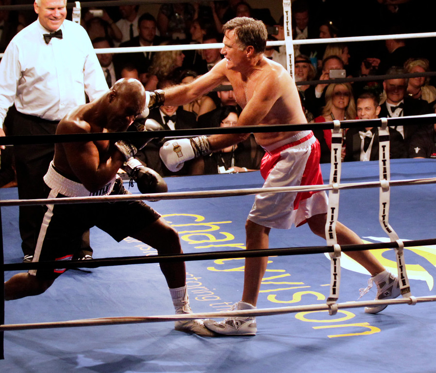 ". Mitt Romney, (R) throws a punch and knocks down Evander Holyfield (L), during a fight  in a charity boxing event on May 15, 2015 in Salt Lake City, Utah. The event was held to raise money for  ""Charity Vision\"" a charity that aims to restore sight to the blind and visually impaired. (Photo by George Frey/Getty Images)"