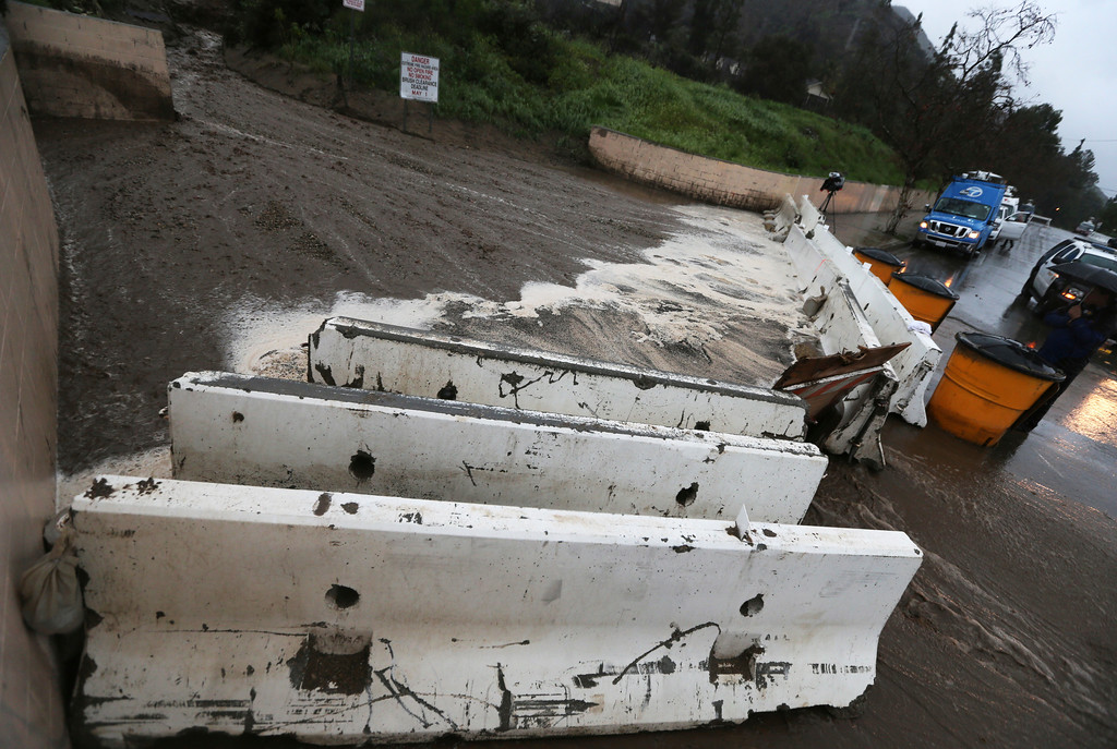 . Mud and debris accumulates behind a barrier in Duarte, Calif., in a threatened area below a burn area know as the Fish Fire, as a powerful storm moves into Southern California Friday, Feb. 17, 2017. The saturated state faces a new round of wet weather that could trigger flooding and debris flows. (AP Photo/Reed Saxon)