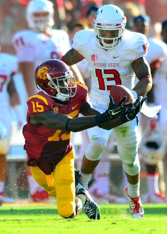 . USC WR Nelson Agholor makes a diving catch behind Fresno State\'s Myles Carr, Saturday, August 30, 2014, at the L.A. Memorial Coliseum. (Photo by Michael Owen Baker/Los Angeles Daily News)