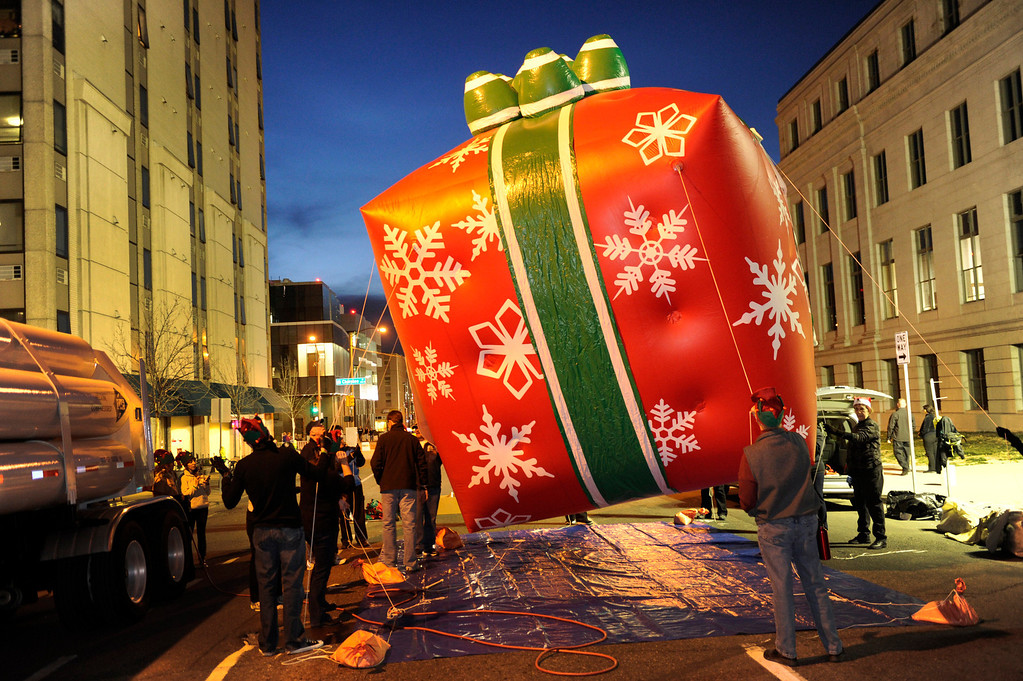 . Crews filled a giant balloon with helium before the parade. The annual Parade of Lights filed past the illuminated City and County building in downtown Denver Friday night, November 30. 2012. The parade with 11 floats, 7 bands, 5 giant balloons and more lights than anyone could count, had enough holiday spirit for everyone. Karl Gehring/ The Denver Post