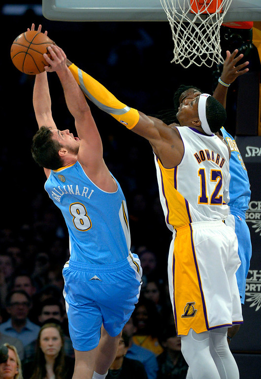 . Los Angeles Lakers center Dwight Howard, right, blocks a shot by Denver Nuggets forward Danilo Gallinari, of Italy, during the first half of their NBA basketball game, Sunday, Jan. 6, 2013, in Los Angeles. (AP Photo/Mark J. Terrill)