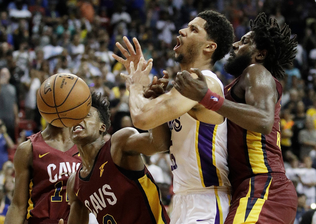. Cleveland Cavaliers\' John Holland, right, fouls Los Angeles Lakers\' Josh Hart during overtime of an NBA summer league basketball game Monday, July 16, 2018, in Las Vegas. (AP Photo/John Locher)