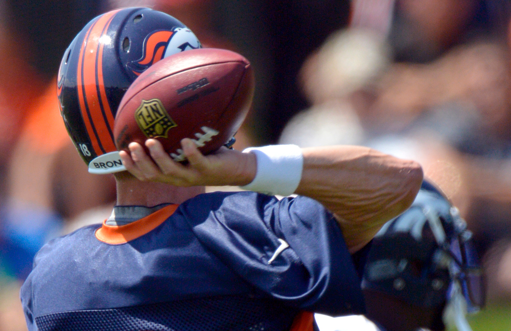 . Denver Broncos Peyton Manning (18) throws a pass during training camp July 26, 2013 at Dove Valley. (Photo By John Leyba/The Denver Post)