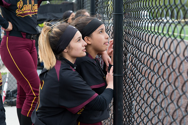 04/29/19 Wesley Bunnell | Staff New Britain softball defeated Conard at Chesley Park on Monday afternoon. Amanda Jacobs (5) and Xandra Silva (3) watch the play from the dugout.