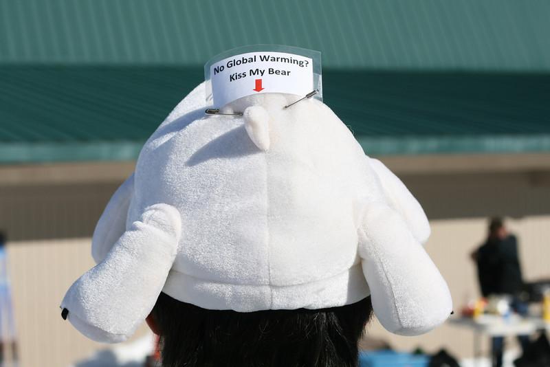 back of Polar Bear hat: No Global Warming Kiss my Rear.