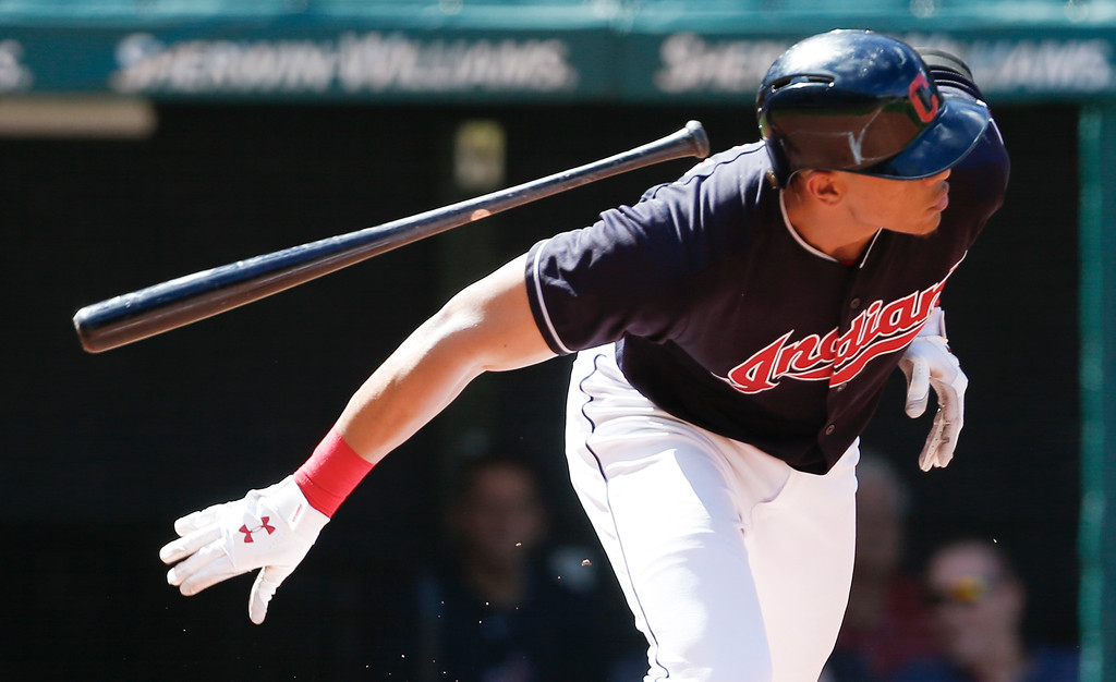 . Cleveland Indians\' Erik Gonzalez hits into a fielders choice off Detroit Tigers starting pitcher Francisco Liriano but drives in a run during the fourth inning of a baseball game, Sunday, Sept. 16, 2018, in Cleveland. (AP Photo/Ron Schwane)