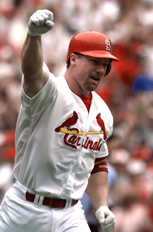 . MARK McGWIRE -- St. Louis Cardinals\' Mark McGwire celebrates his 61st home run of the season in the first inning off Chicago Cubs pitcher Mike Morgan on Sept. 7, 1998, in St. Louis. The homer tied Roger Maris\'  37-year-old major league home run record of 61. (AP Photo/Eric Draper)