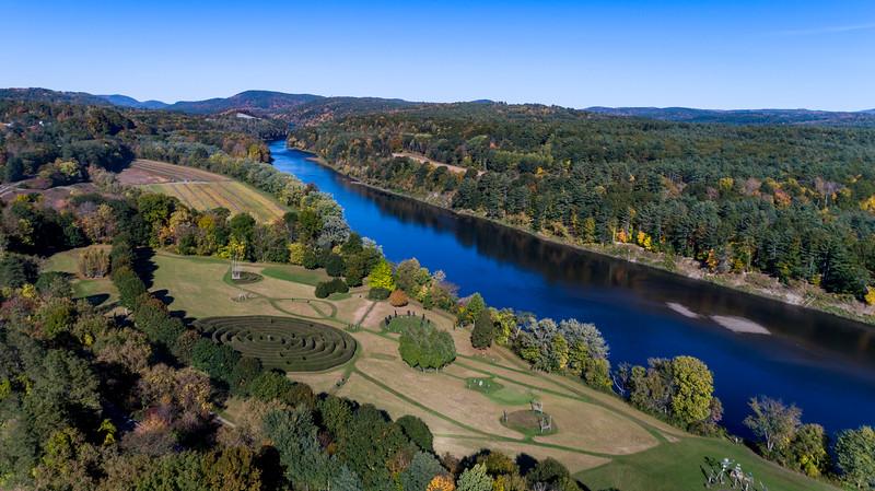 The Path of Life sculpture garden nestled alongside the Connecticut River in Artisans Park in Windsor, VT. #myvermont #uppervalleyvtnh #aerialphotography #dronephotography #vtphotographer #windsorvt