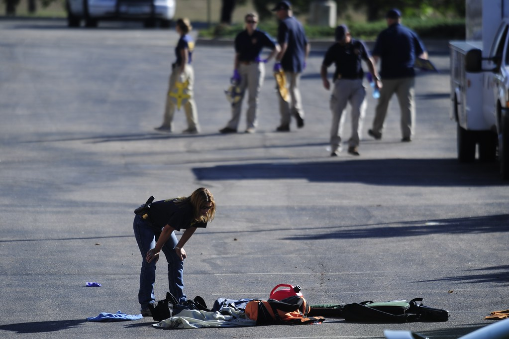 . Agents from the FBI and ATF investigate the scene behind the Century 16 theater in Aurora where 12 people were killed and dozens of others were injured during a premier of The Dark Knight Rises on Friday, July 20, 2012 in Aurora. AAron Ontiveroz, The Denver Post