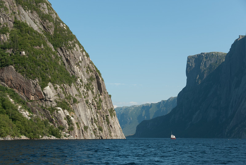 A solitary boat amidst the Gros Morne Mountain in Newfoundland, Canada