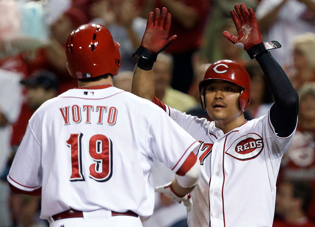 . Cincinnati Reds\' Joey Votto (19) is congratulated by Shin-Soo Choo (17) after Votto hit a two-run home run off Los Angeles Dodgers relief pitcher J.P. Howell in the fifth inning of a baseball game, Friday, Sept. 6, 2013, in Cincinnati. (AP Photo/Al Behrman)