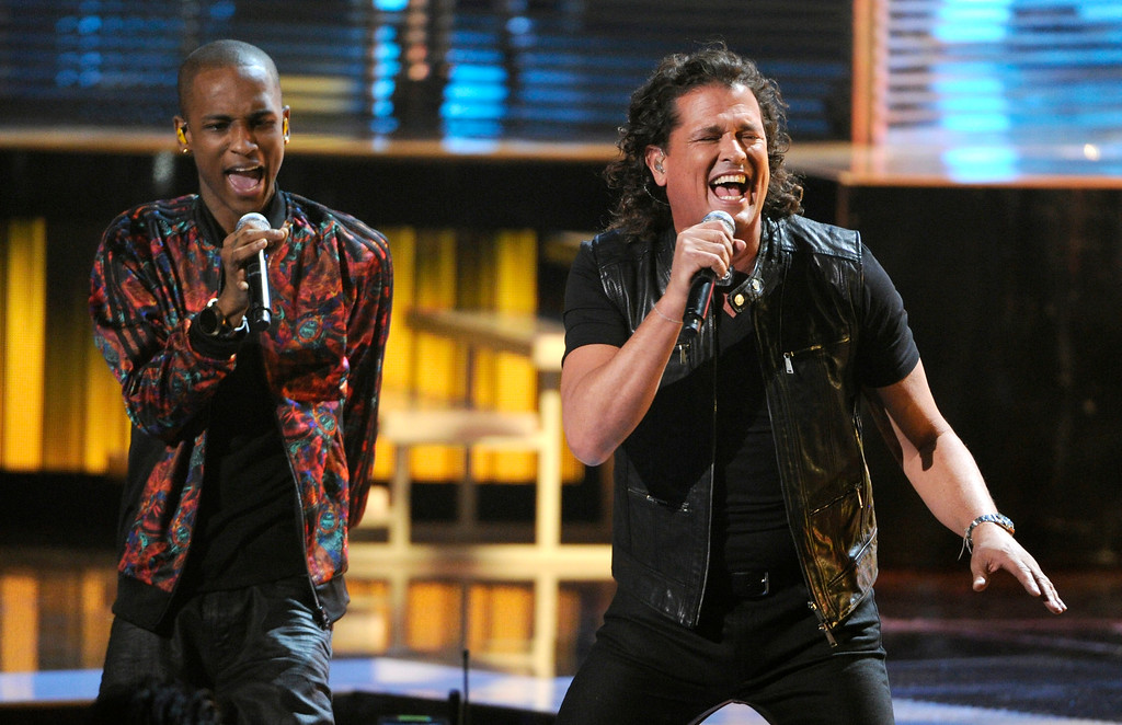 . Miguel Martinez, of the musical group ChocQuibTown, left, and Carlos Vives perform at the 15th annual Latin Grammy Awards at the MGM Grand Garden Arena on Thursday, Nov. 20, 2014, in Las Vegas. (Photo by Chris Pizzello/Invision/AP)