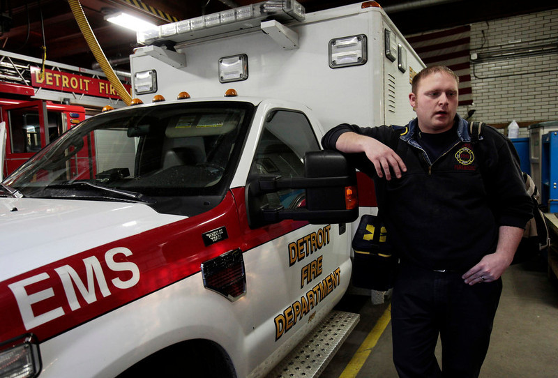 . Detroit Firefighters Paramedic Jeff Roberts stands by an ambulance as he waits for a call in a Fire Station on the east side of Detroit, Michigan March 22, 2013.  When the state-imposed manager of Detroit, Kevyn Orr, begins the job on Monday he will wade into a city of crumbling neighborhoods where police fail to respond to some calls, arson fires burn out of control, and residents scour charred buildings for scrap metal to sell. Picture taken March 22, 2013. REUTERS/ Rebecca Cook