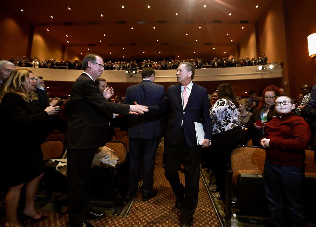 . Ohio Governor John Kasich, center, enters the Fritsche Theater at Otterbein University in Westerville, Ohio, to deliver the Ohio State of the State address Tuesday, March 6, 2018. (AP Photo/Paul Vernon)