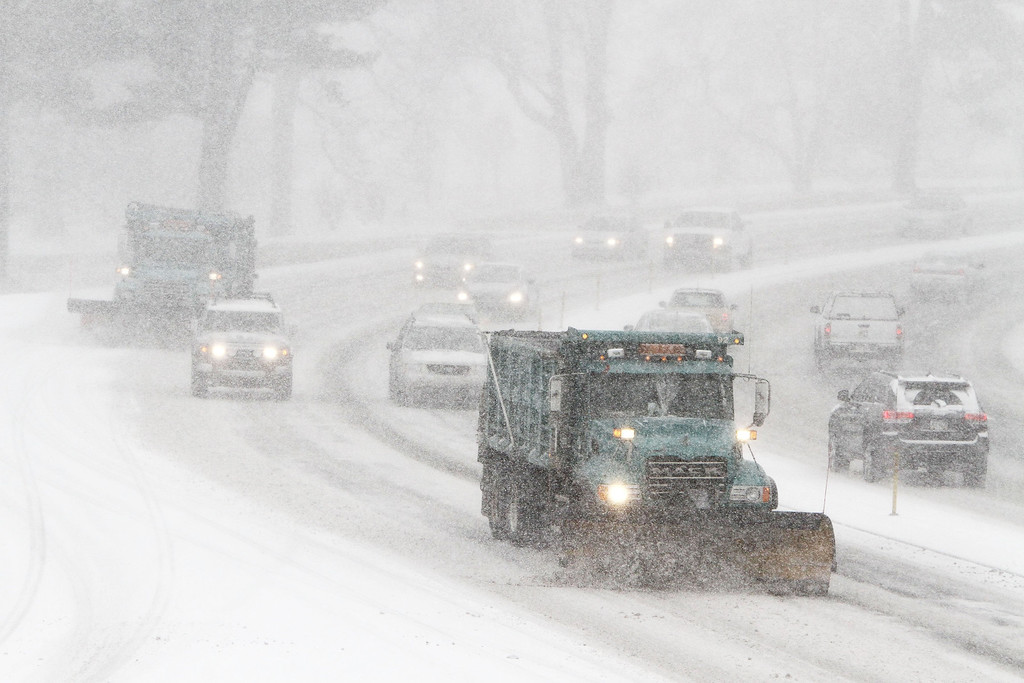 . A snow plow tries to keep lanes clear in Philadelphia on Tuesday, Jan. 21, 2014, at the beginning of a winter storm set to hit the northeast. (Michael S. Wirtz/Philadelphia Inquirer/MCT)