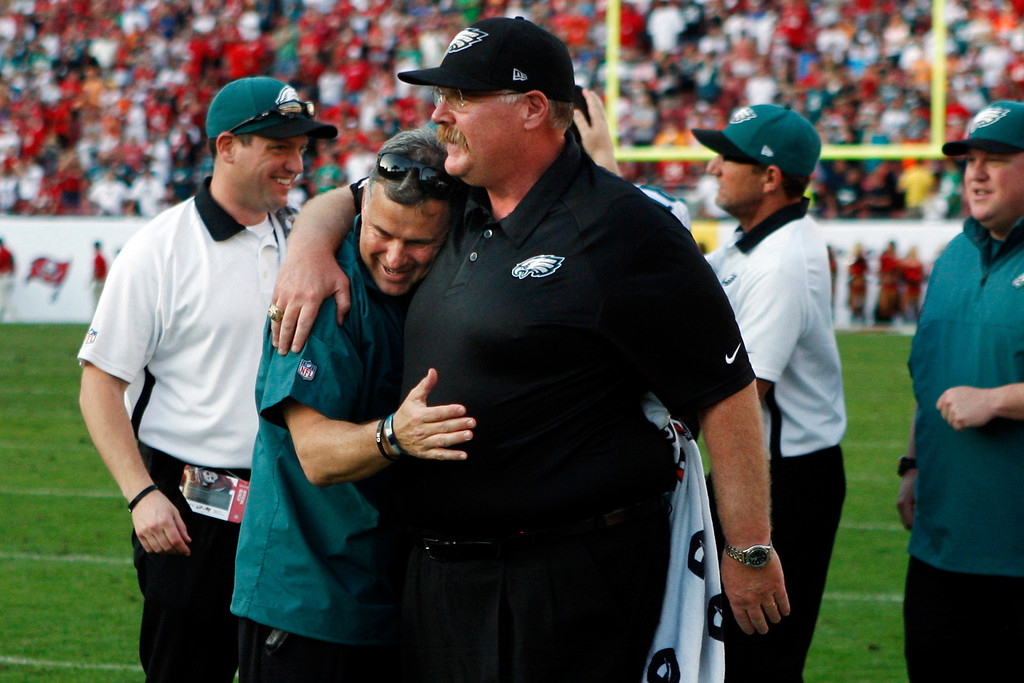 . Philadelphia Eagles head coach Andy Reid is hugged by head athletic trainer Rick Burkholder after the team\'s final touchdown drive against the Tampa Bay Buccaneers during the fourth quarter of their NFL football game, Sunday, Dec. 9, 2012, in Tampa, Fla. The Eagles won 23-21. (AP Photo/The Philadelphia Inquirer, Ron Cortes)