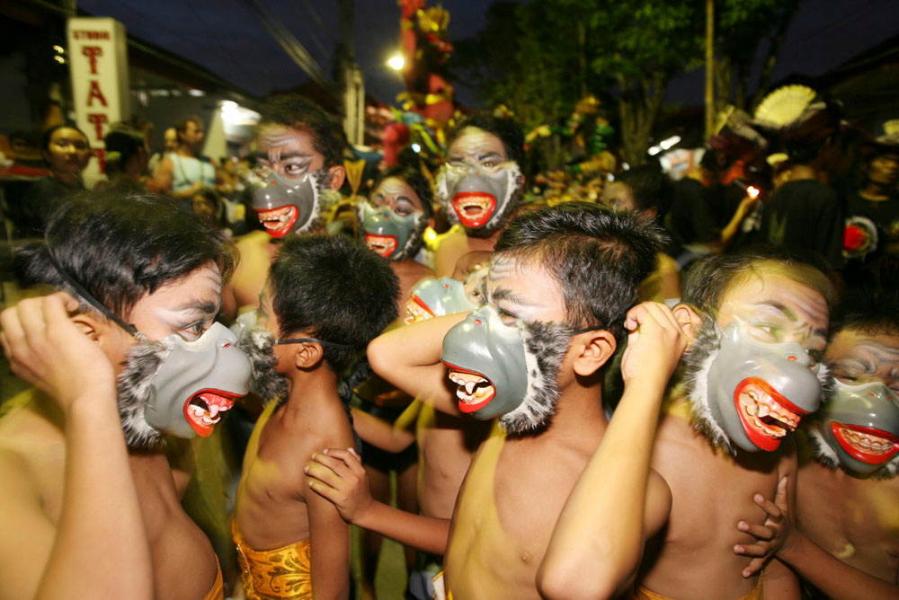 Description of . Balinese boys put on monkey masks during a traditional ceremony to ward off evil spirits on the eve of Nyepi or Hindu Day of Silence on March 18, 2007 in Kuta, Indonesia.  The resort island of Bali will be closed for 24 hours on March 19, to observe Nyepi, which marks the beginning of the Balinese-Hindu New Year. During Nyepi, the majority of the island's 3.5 million inhabitants observe a silence to help with meditation, contemplation and to pray for a better future. (Photo by Dimas Ardian/Getty Images)